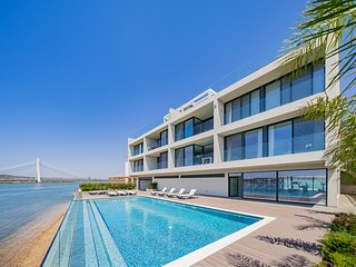 Stylish Riverside Apartment | Overlooking Arade River | Lagoa | Pool | Gym