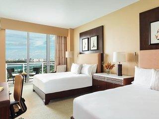 Ritz Carlton Hotel-5 Star-One Bedroom-2 beds- High Floor–Ocean View-Beach Front
