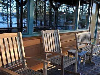 Relax on Front Deck and take in beautiful Lake, Marina and Mountain views