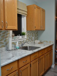 Section of kitchen, cheerful and bright. Extremely well equipped to make any meal during your stay