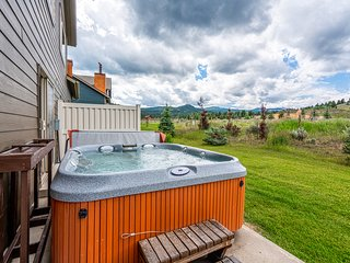 Rustic home w/ a wood stove, private hot tub, & stunning mountain views!