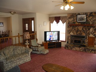 Love Seat, Recliner, 55' HDTV and Wood Burning Fireplace (Firewood provided)