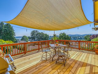 Charming home w/ fenced yard, spacious deck, nice views & gas grill!