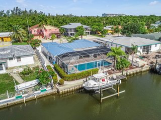 NEW LISTING! Waterfront home w/ private pool and deck - close to the beach!
