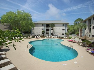 NEW LISTING! Charming condo with shared pool and tennis - blocks from beach!