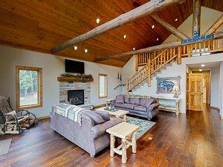 Gorgeous lakefront lodge w/ a furnished deck, firepit, dock, & boat