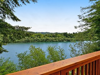 Lovely riverfront home with wraparound deck, cozy fireplace, direct river access