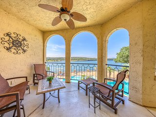 Elegant lakefront condo w/ a spacious balcony, shared pool, hot tub, & much more
