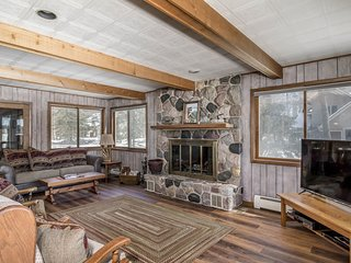 Secluded waterfront home between 2 lakes w/ heated porch, dock, kayaks & rowboat