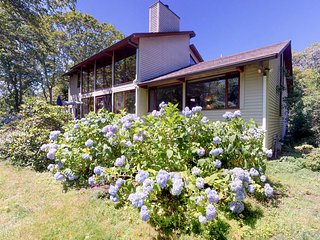 NEW LISTING! Mid-century home w/ deck, fireplace & huge windows - 1 dog OK!