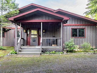 Presque Isle home on Musky Lake w/screened-in porch & private dock