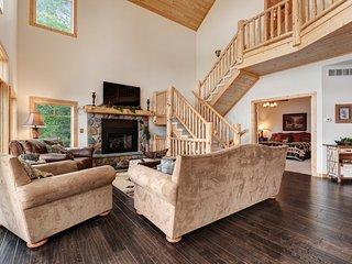 Luxurious, lakefront, cabin-style home with wet bar, dock & views