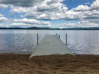 NEW LISTING! Lakefront home with 100 feet of sandy beach on Ossipee Lake!
