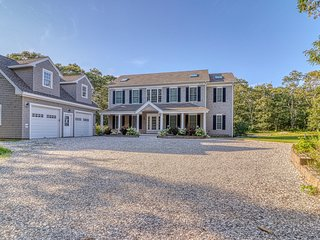 Classic, private estate with a large lot, a stone patio & a fireplace!