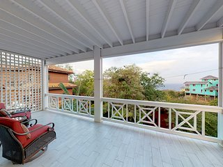 New listing! Two-level home w/ sea view & balconies to enjoy the breeze & sunset