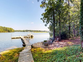 Dog-friendly, lakefront home w/water views, dock, firepit & foosball table!