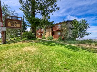 Ski-in/ski-out condo with shared hot tub, sauna, and sweeping tree-lined views!