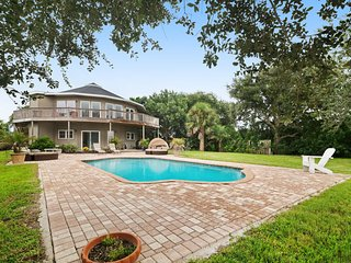 Stunning waterfront home just minutes from the beach w/private pool and dock