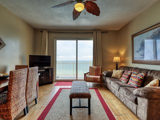 Waterfront condo w/ a private furnished balcony, shared pool, gym, & beach