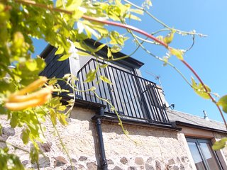 Plum Tree Cottage, a charming cottage for two on an organic farm, spiral stairs