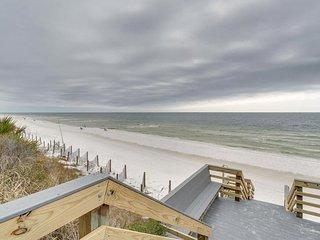 Cozy coastal efficiency w/ a shared pool & easy beach access