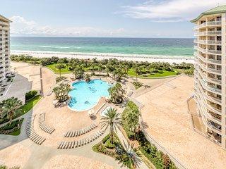 Luxurious beachfront rental with private balcony, resort pool, hot tub, & sauna