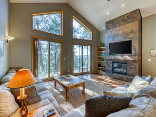 Newly built, secluded home w/ a large deck, two fireplaces, & mountain view