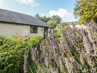 HAZEL COTTAGE, ground-floor, shared use of indoor heated swimming pool, close