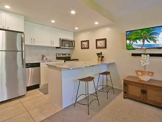 Newly renovated kitchen (Fall 2018) with granite counter tops, cabinetry w/ stainless appliances.