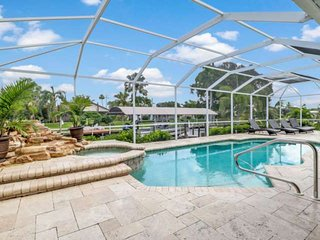 Ultimate Outdoor Living! Luxurious Yacht Club Area Pool Home! Gulf Access Canal!