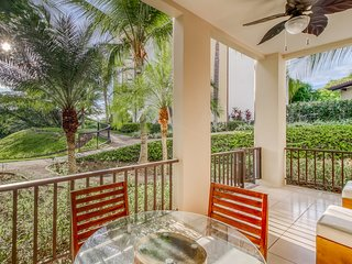 Luxury ground-level condo with shared pool, and gated entrance