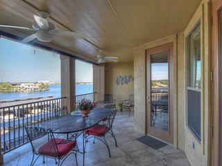 Upscale lakefront resort condo w/lake views, shared pool, & day dock!