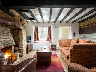 The living room has a wealth of character features including exposed beams...