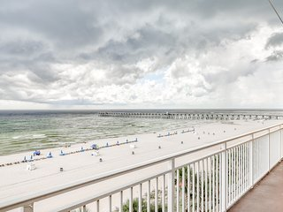 Waterfront condo w/ beach views, a shared pool, fitness room, & grilling area