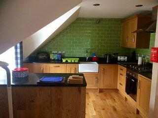 Open plan kitchen. Belfast sink. Granite worktops. Oak fittings. Fully equipped for self catering.