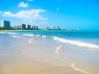 Enjoy Isla Verde in a spacious luxury condo with 3BR-2BTH plus City & Ocean View