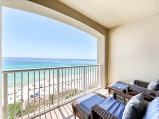 Beachfront condo rental w/ a private balcony plus shared pools, a hot tub, & gym