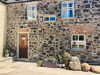 Coachman's Cottage. 5 Star Renovated 18th Century Stone Cottage near Dark Hedges