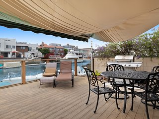 Waterfront home with large sun deck, harbor views, & close to sites
