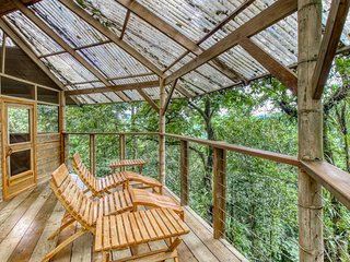 Adorable, two-story treehouse getaway w/ a furnished balcony, kitchen, & view