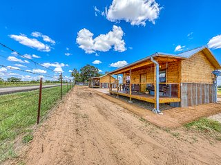 Two side-by-side cabins w/ private hot tubs & furnished front porches