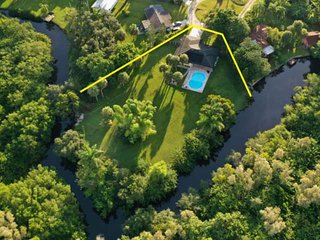 Secluded N Fort Myers Family Home! Solar Heated Pool - .75 Acres w/Canal - Fire
