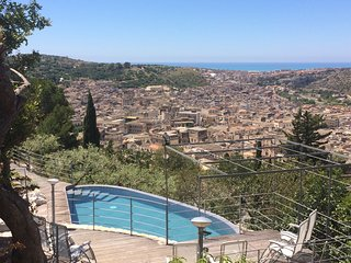 Villa dell'Acanto  heated swimming pool with town and sea view