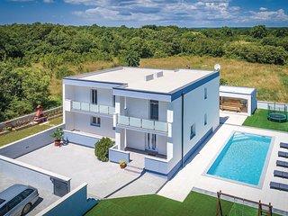 Stunning home in Loborika w/ WiFi, 5 Bedrooms and Outdoor swimming pool (CIR359)