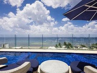 Brand New Classy Condo Just Steps from the Beach