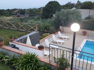 Villa with private pool, beautiful views of Mount Etna and the Ionian sea.