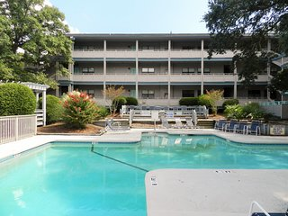 Beautiful garden condominium with large pool & short walk to beach