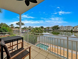 Luxurious waterfront home w/ a private, heated pool - right across from a park