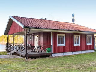 Nice home in Holmsjo w/ Sauna and 3 Bedrooms (S03153)