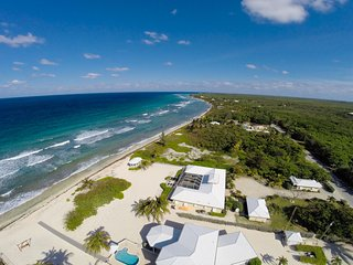 Cayman Sands: Secluded Beach Villa with Pool Atrium & Guest Cottage